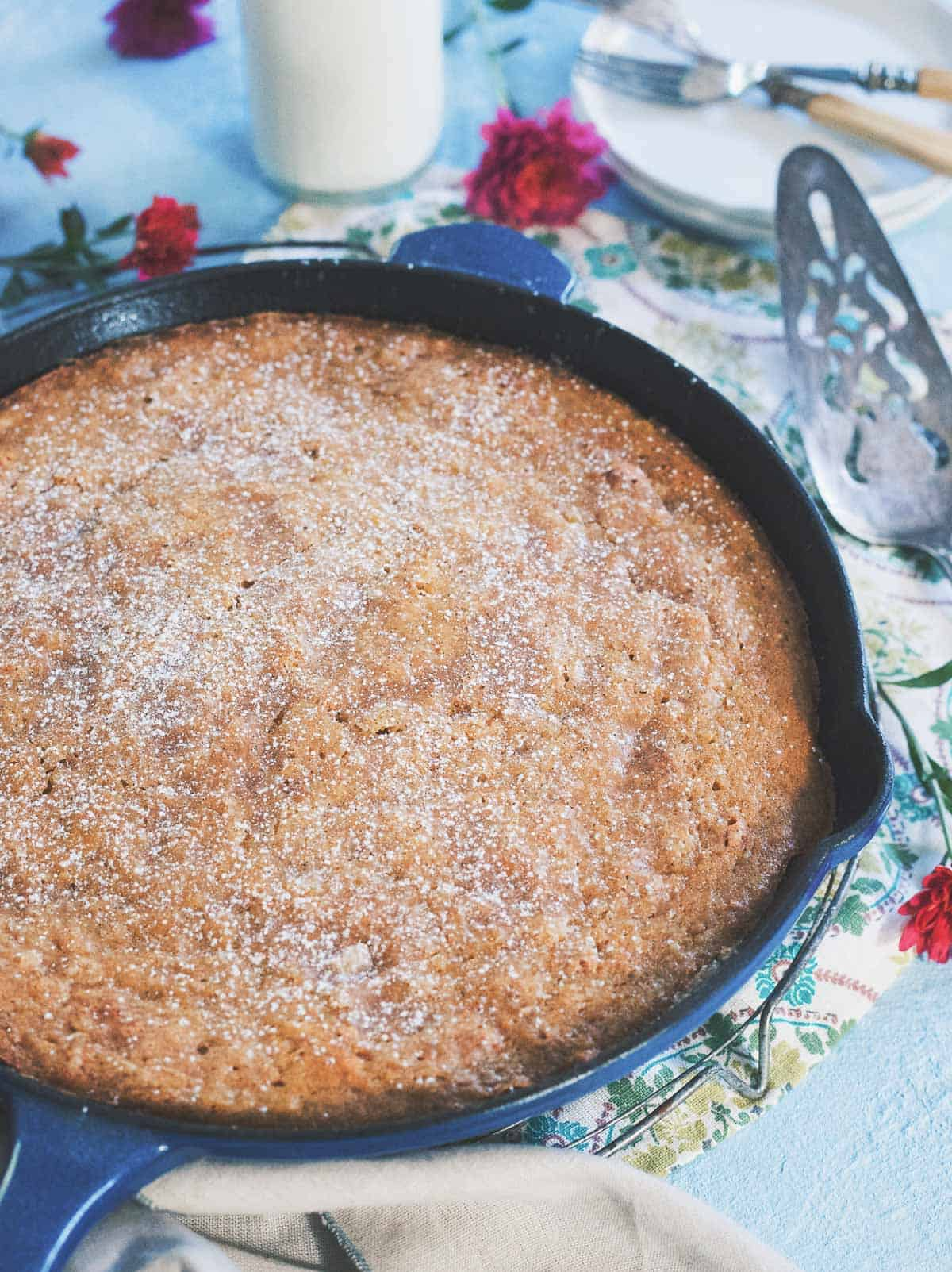 Made with applesauce, golden raisins and apple cider, this easy skillet cake is the quintessential fall dessert.