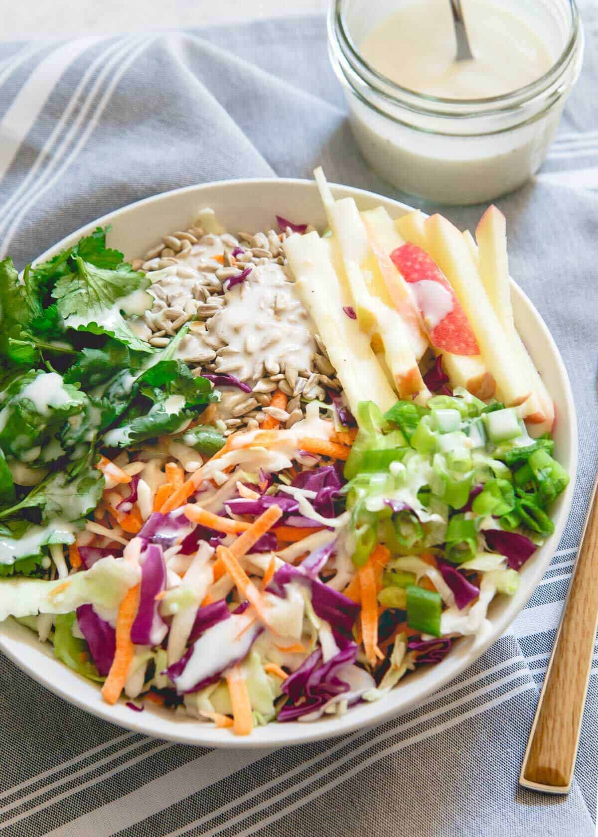 This kefir honey mustard dressing is creamy, tangy and boosted with both naturally occurring probiotics and a probiotic powder supplement to up your healthy salad game!