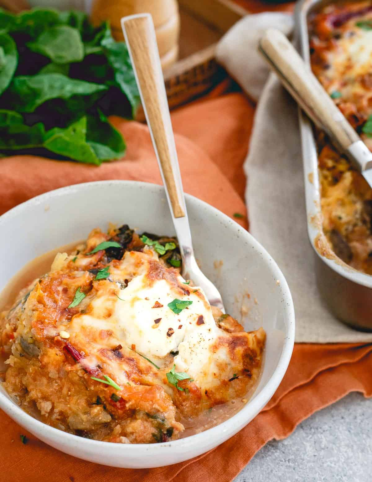 Cheesy, hearty and delicious, you won't miss the noodles in this spaghetti squash baked ziti.