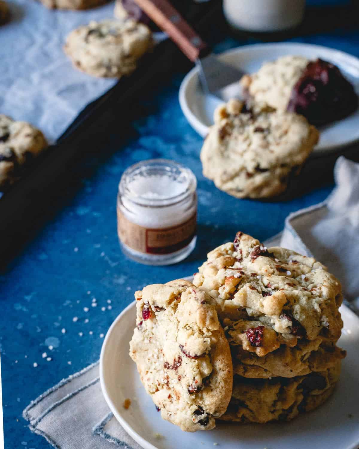 A glass of milk and a couple of these cranberry almond chocolate chip cookies is the perfect holiday inspired treat.