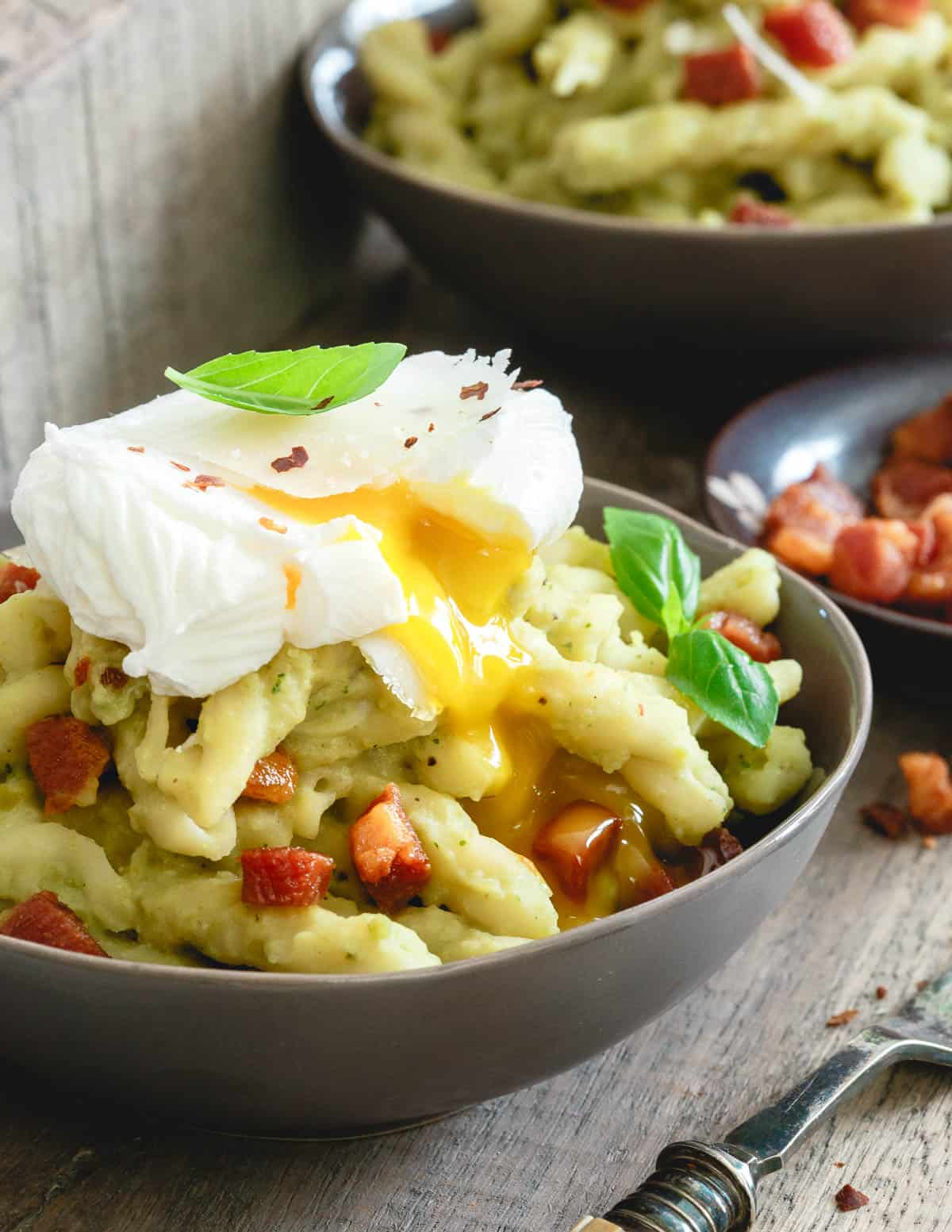 Crispy pancetta, a poached egg and creamy split pea pesto all tossed together with al dente gemelli pasta is pure comfort food.