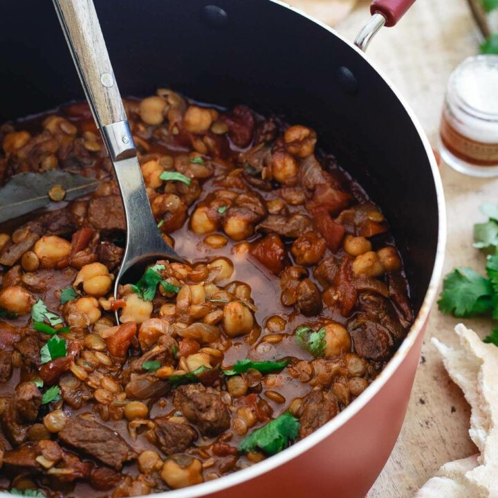 This lamb lentil stew is flavored with Moroccan spices and beefed up with chickpeas. Serve with fresh cilantro and a dollop of yogurt for a hearty and comforting winter meal.