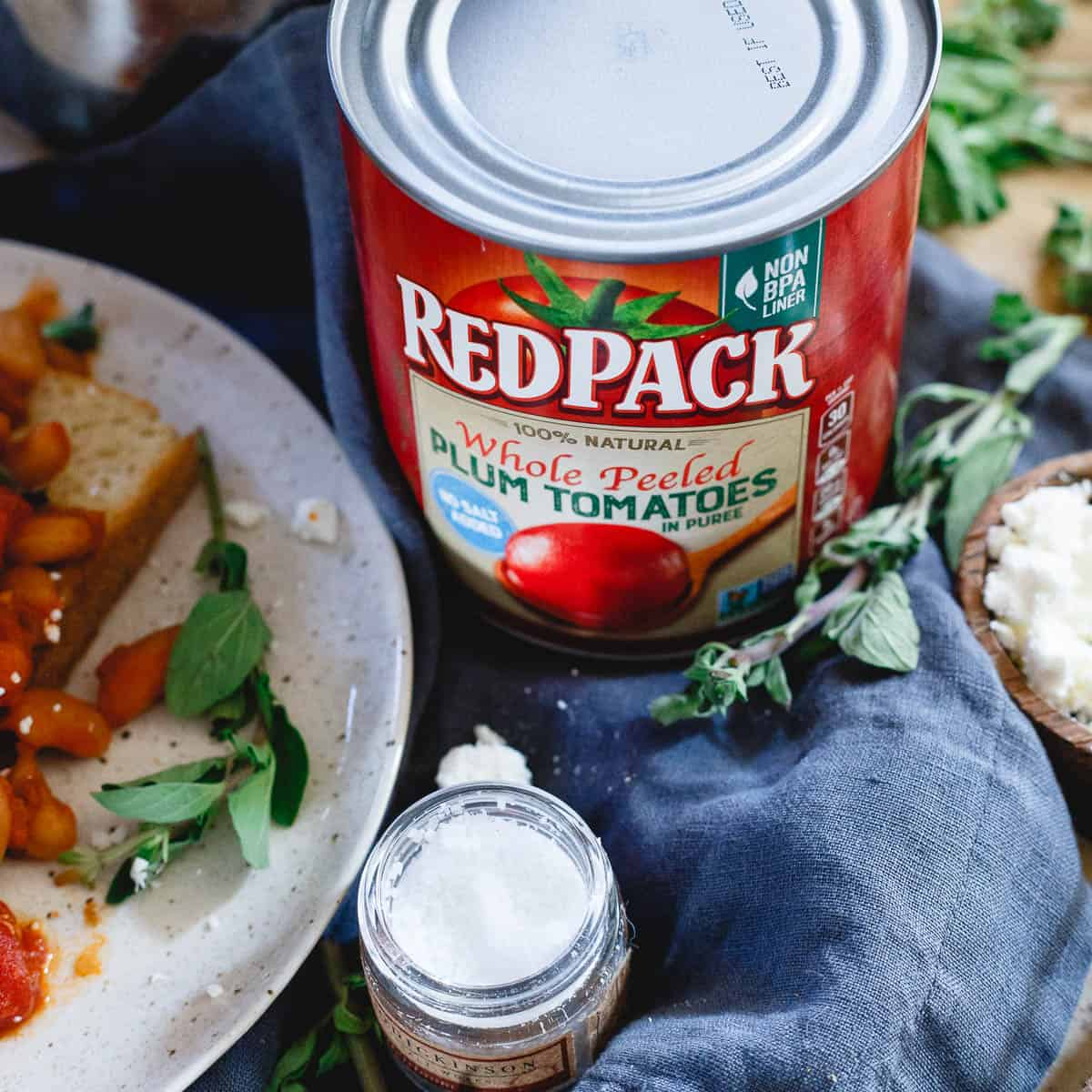 RedPack whole peeled plum tomatoes give this hearty white bean dish a lovely tomato flavor. Combined with bacon and onions, it's a cozy meal perfect for winter.