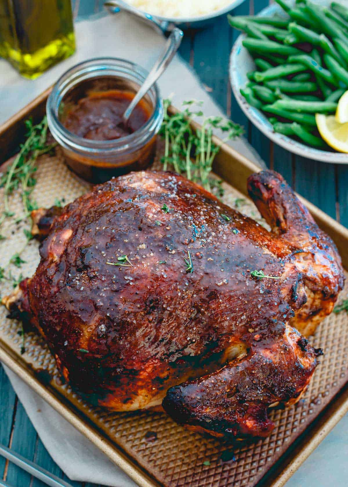 This apple butter roasted chicken is a killer combination of sweet and savory flavors. With a crispy outside and a juicy, tender inside, it's the perfect Sunday dinner!