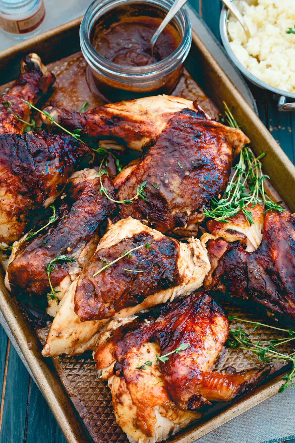 Sweet and savory apple butter is used as a saucy glaze on this roasted chicken for a great Sunday night meal.