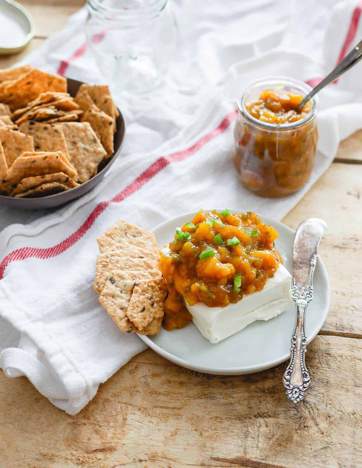 This jalapeno mango jam is the perfect balance of sweet and spice. It's equally delicious with some soft cheese and crackers as it is swirled in some yogurt!