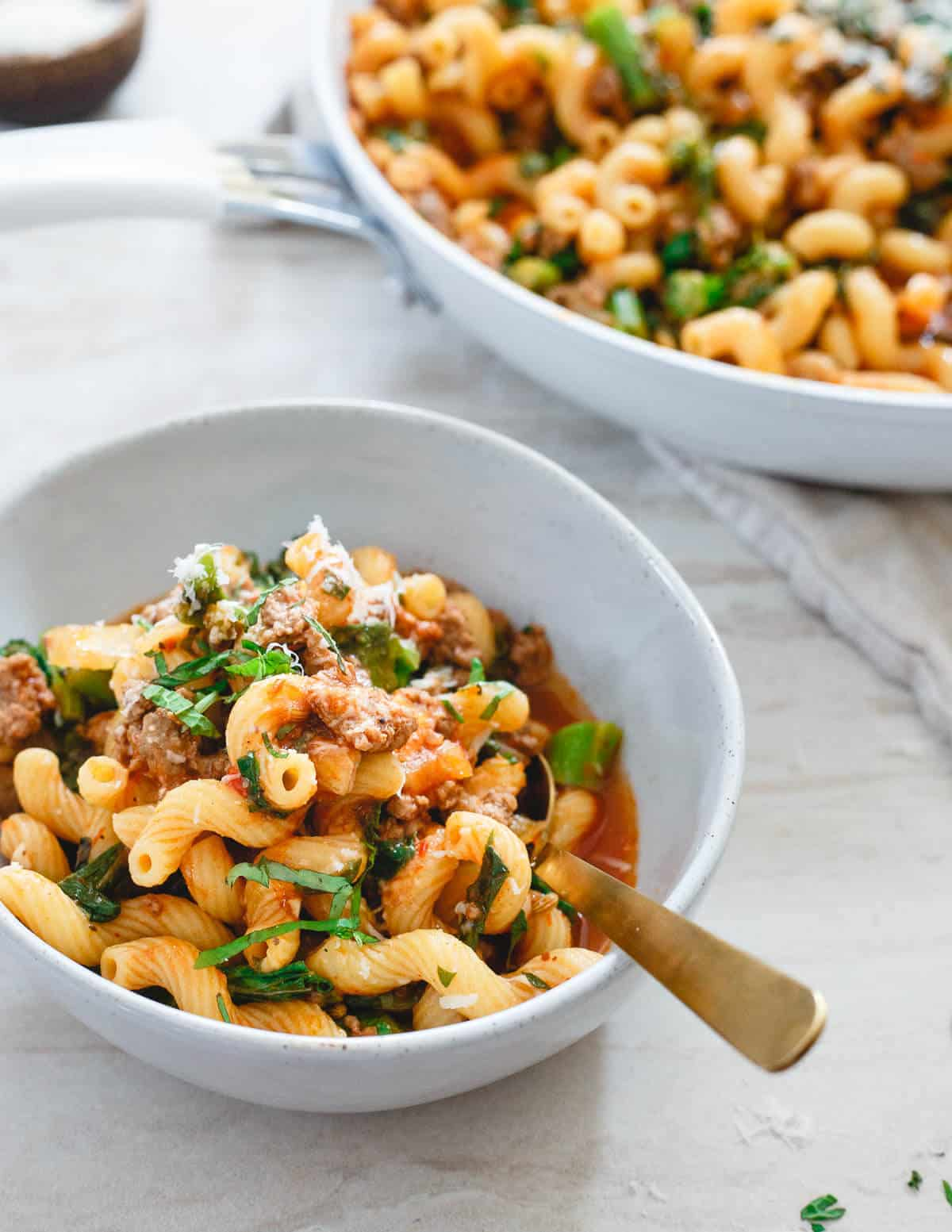 This lamb ragu is a spicy, spring inspired one-skillet dinner. Cavatappi pasta, crushed tomatoes and harissa paste make it flavorful and hearty.