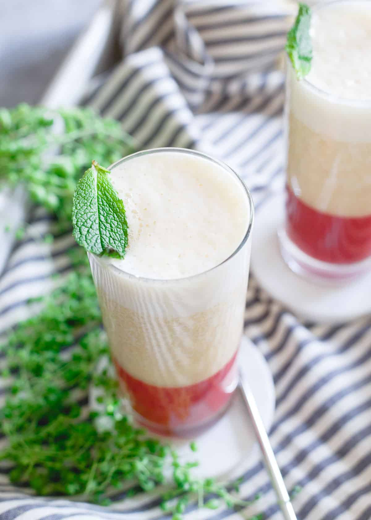 Strawberry ginger puree is a refreshing bottom layer to this peach banana smoothie.