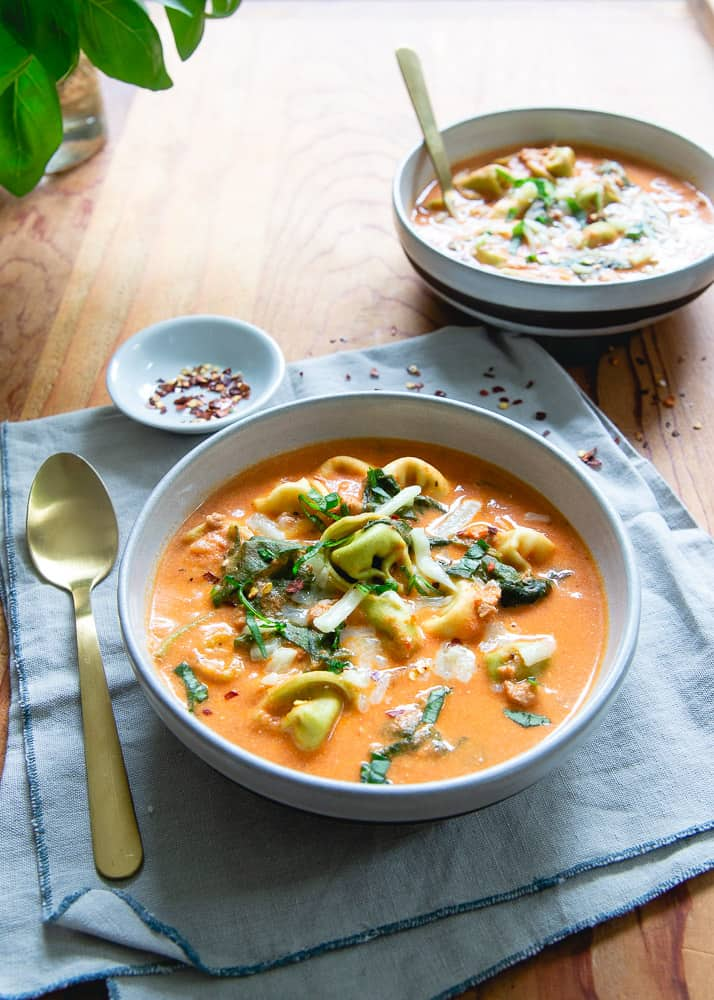This creamy tomato tortellini soup is made in no time in the Instant Pot or pressure cooker. Majorly creamy and cheesy and packed with bright summer basil!