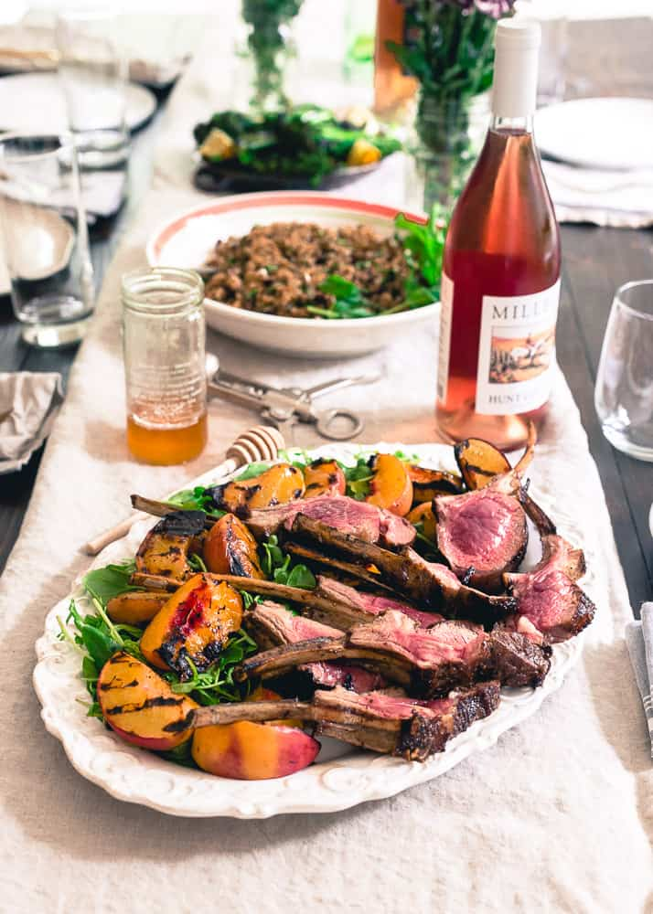These grilled lamb chops are glazed with sweet peach honey and served with a simple watercress and grilled peach salad for the perfect summer meal.