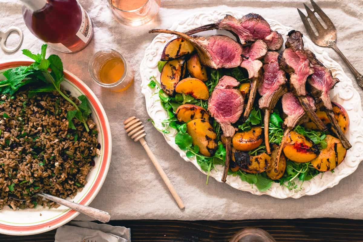 A summer spread of grilled lamb chops with peach honey and a wild rice, mint, dried cranberries, feta and seed mixture is an easy summer meal to entertain with.