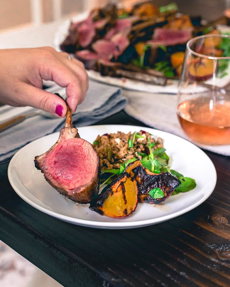 Medium rare grilled lamb chops with grilled peaches and a simple watercress salad is easy and impressive for a summer grill out!