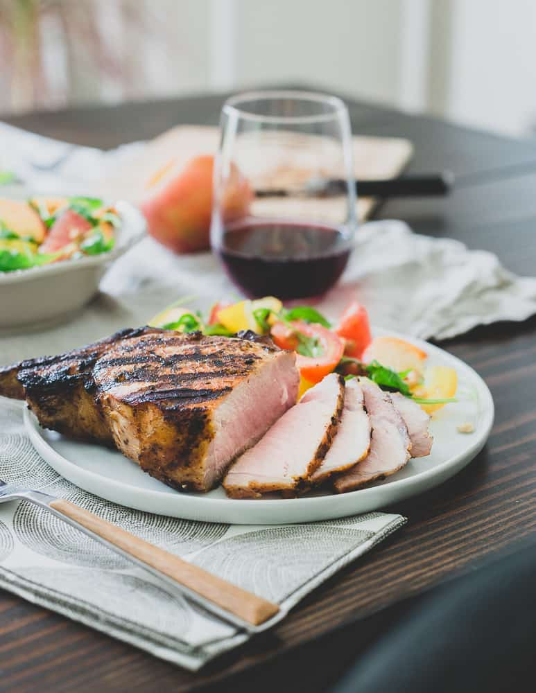 Fire up the grill and get these harissa rubbed pork chops on before summer's over. Paired with a tomato peach salad, it's a simple but satisfying meal.