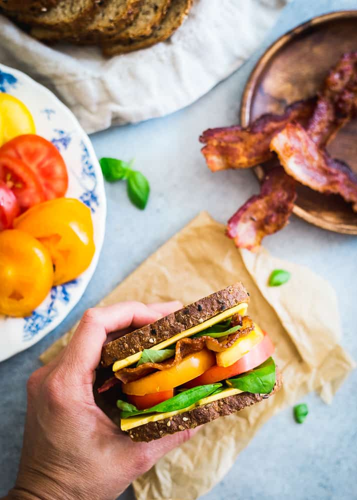 A summer inspired BLT with cheese on multigrain seeded bread is a delicious seasonal lunch.