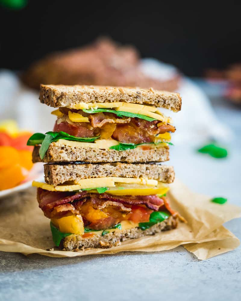Basil and heirloom tomatoes put a seasonal spin on the classic BLTC (bacon, lettuce, tomato and cheese).