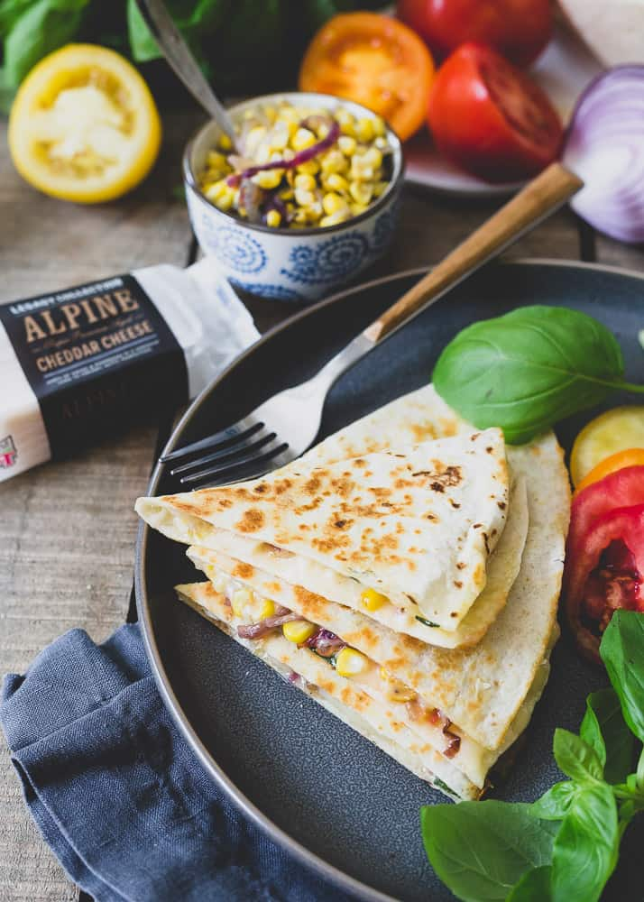 This cheddar quesadilla is filled with all the best end of summer produce like garden ripe tomatoes, fresh basil and sweet corn. It's a quick, easy, meatless meal to celebrate the season!