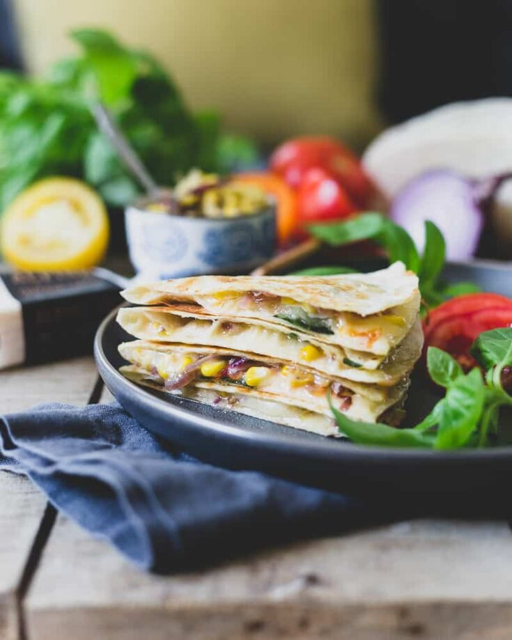 This summer harvest cheddar quesadilla is filled with juicy ripe heirloom tomatoes, fresh corn, basil and melted sharp cheddar cheese. A delicious way to celebrate summer's bounty.