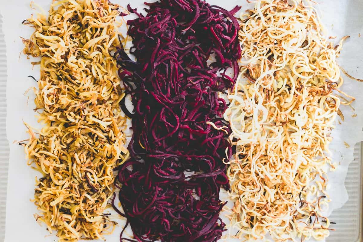 Spiralized winter root vegetables with toasted pecans, cranberries and blue cheese make a festive holiday side dish.