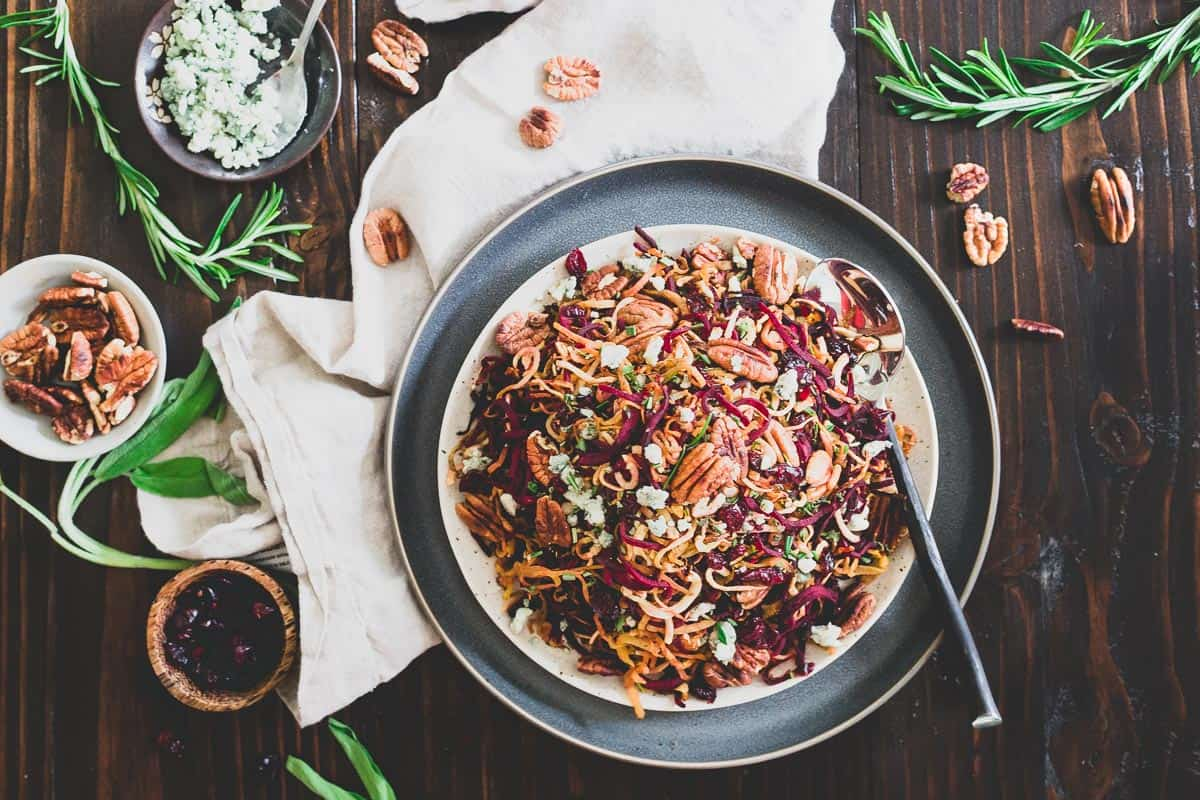 Spiralized beets and parsnips tossed with toasted pecans, dried cranberries, blue cheese crumbles and balsamic vinegar make this roasted winter root vegetable salad an explosion of seasonal flavors.
