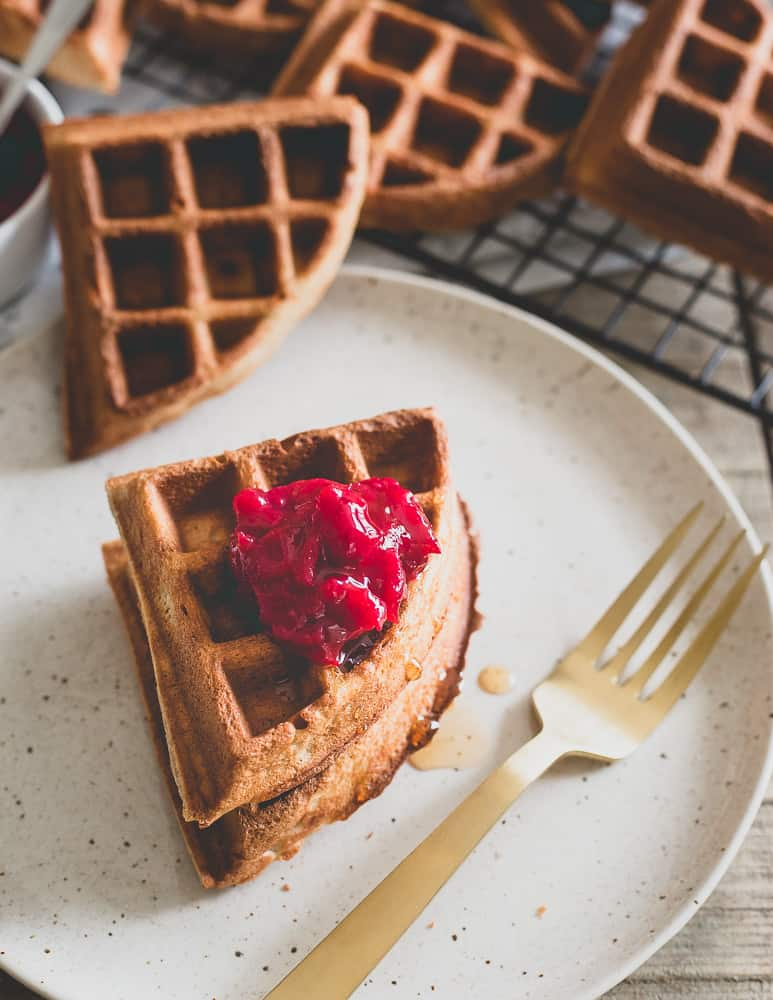 Nutty and malty chestnut flour waffles with a hint of cardamom and a vanilla cranberry compote make a delicious winter inspired breakfast.