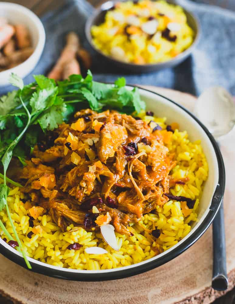 Aromatic spices and creamy coconut milk make this Instant Pot coconut pork absolutely delicious over turmeric and ginger rice.