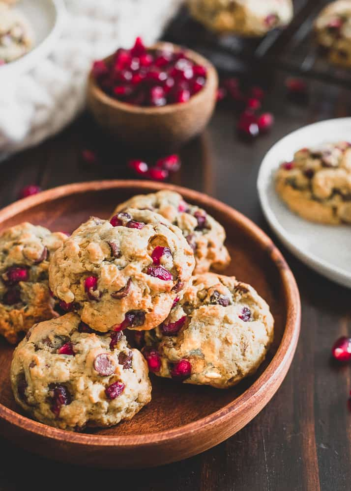 These pomegranate oatmeal chocolate chip cookies are flavored with orange zest and extract to make the perfect winter themed cookie. A great addition to your holiday baking!