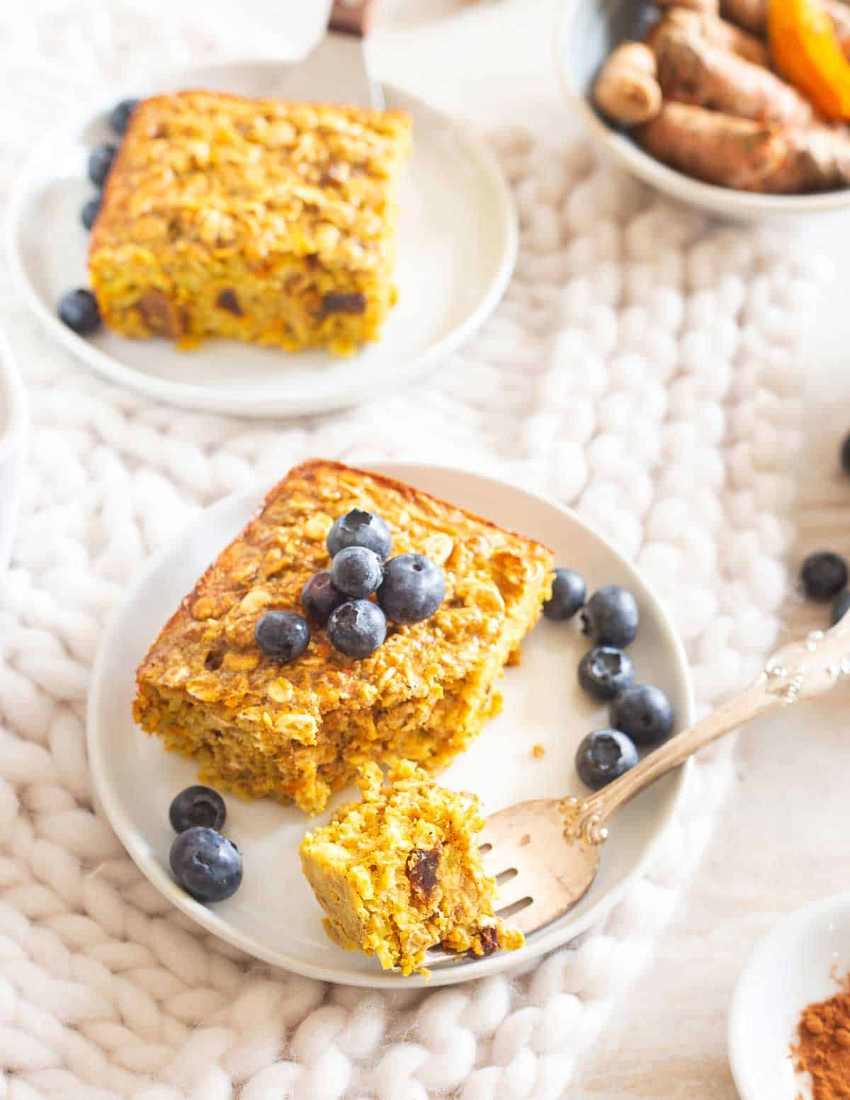 Baked turmeric oatmeal is studded with cinnamon and raisins for a healthy and hearty anti-inflammatory breakfast and easy to make ahead.