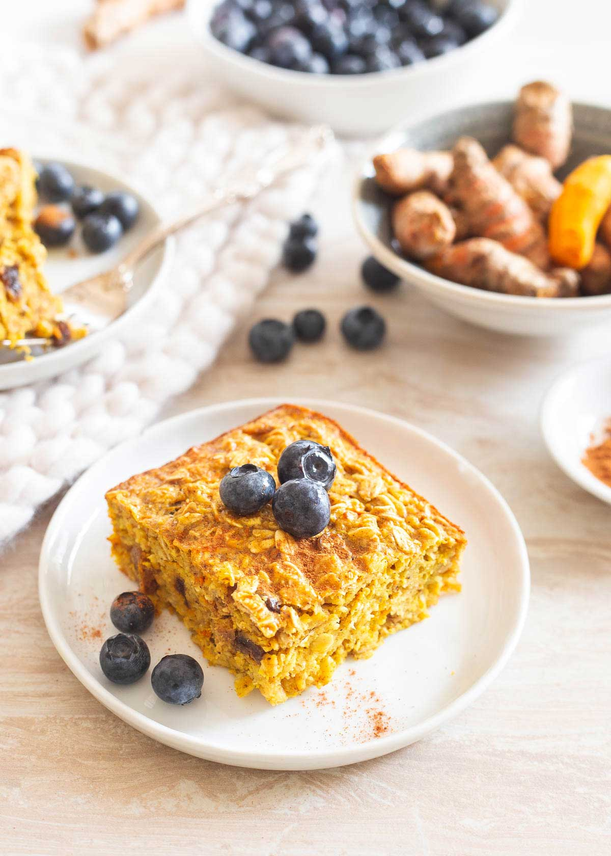 Golden baked oatmeal made with fresh turmeric is healthy, delicious and perfect for breakfast meal prep!