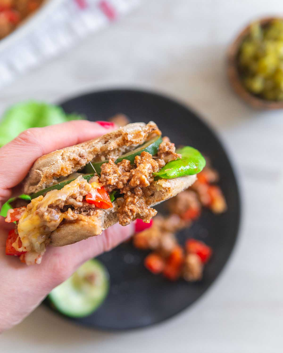 Lean ground beef, low-fat cheese and low sugar condiments make these healthier sloppy joes a great alternative to the traditional dinner.