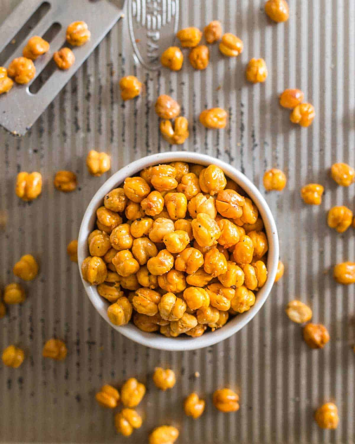 Roasted chickpeas are snack-worthy little protein-packed bites that make a fun appetizer alternative to nuts or a great salad topper.