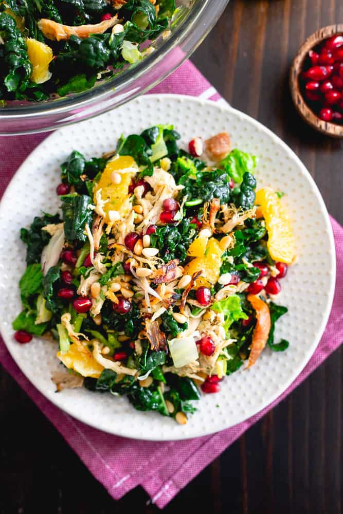 This chopped winter salad is packed with crispy rotisserie chicken, bright winter citrus, pomegranates, toasted pine nuts, fresh herbs and hearty bed of Tuscan kale then tossed in an orange dijon dressing.