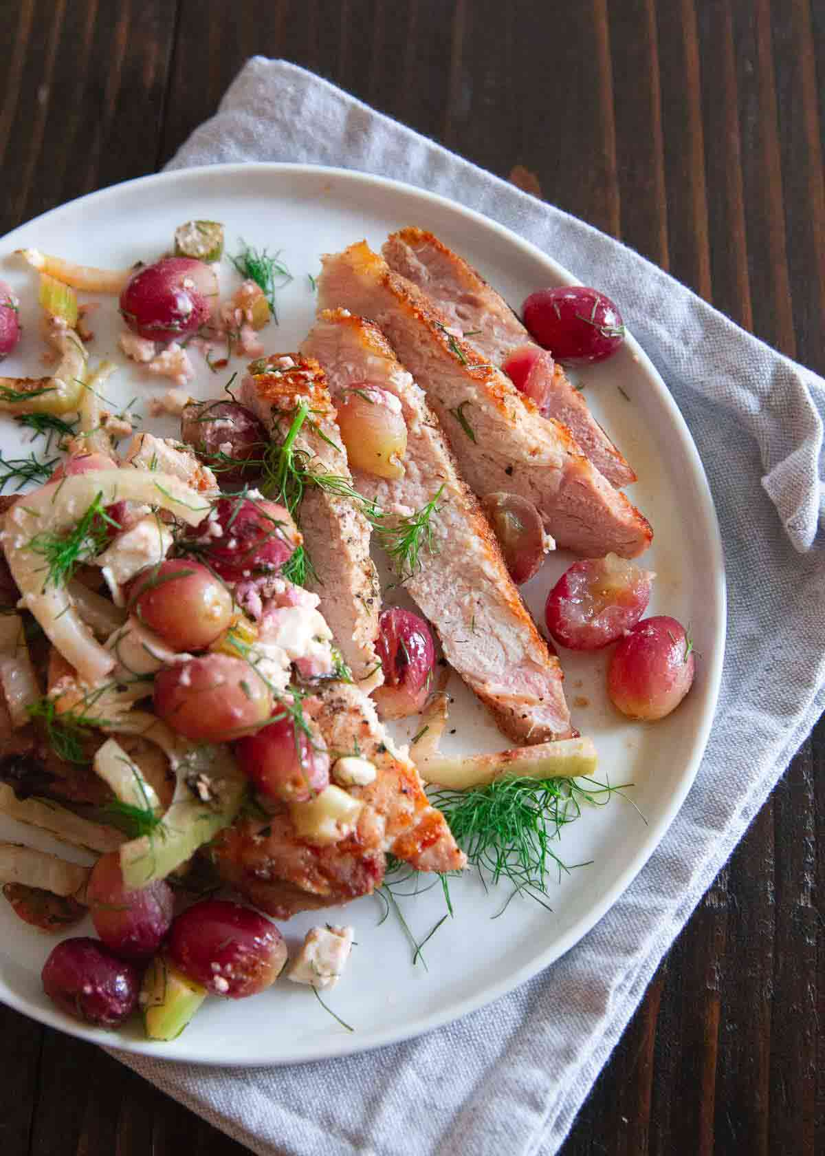 This easy grilled meal of pork chops with fennel and grapes was the perfect way to break in our new Weber Genesis ii grill.