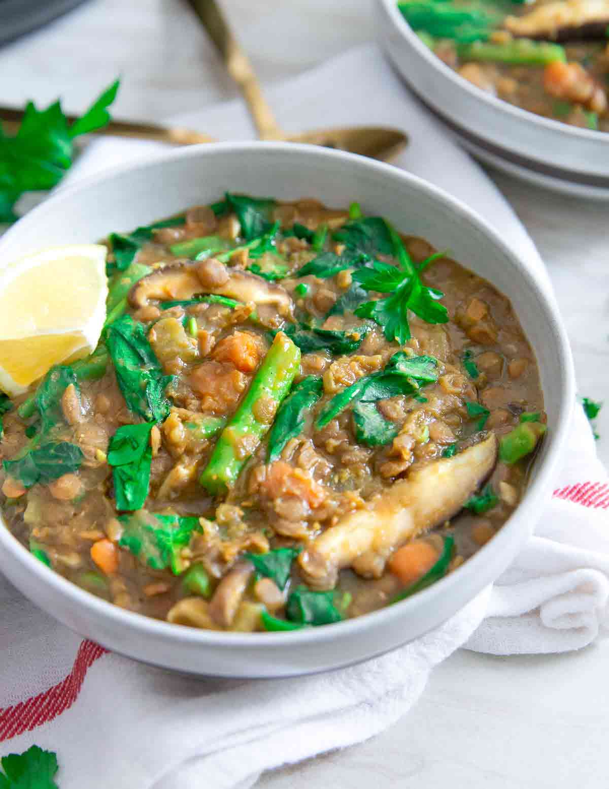 This lentil vegetable soup is packed with mushrooms, green beans and spinach, made entirely in the Instant Pot for a quick and easy comforting vegetarian meal full of flavor.