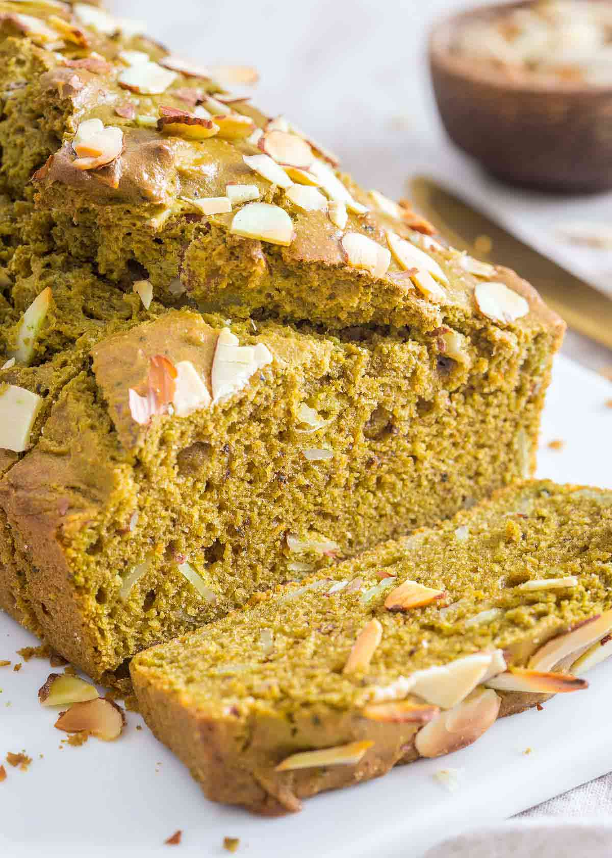 This matcha bread recipe uses almond flour, almond extract and sliced almonds for a lovely moist and aromatic quick bread with all the benefits of green tea powder.