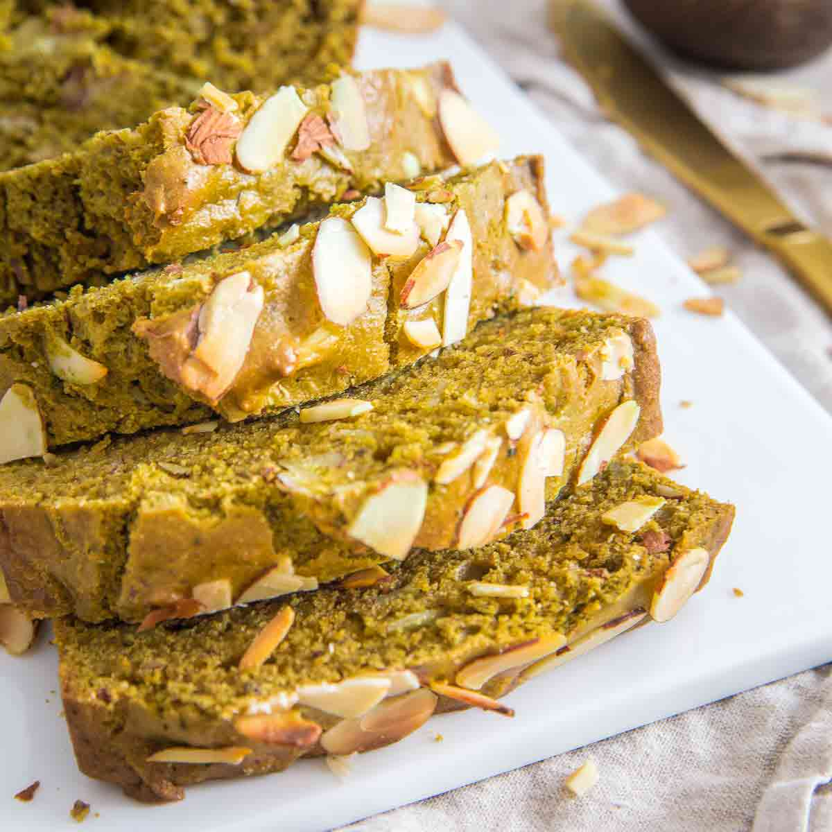 Green tea bread made with sliced almonds, almond flour and almond extract is packed with flavor in each moist slice.
