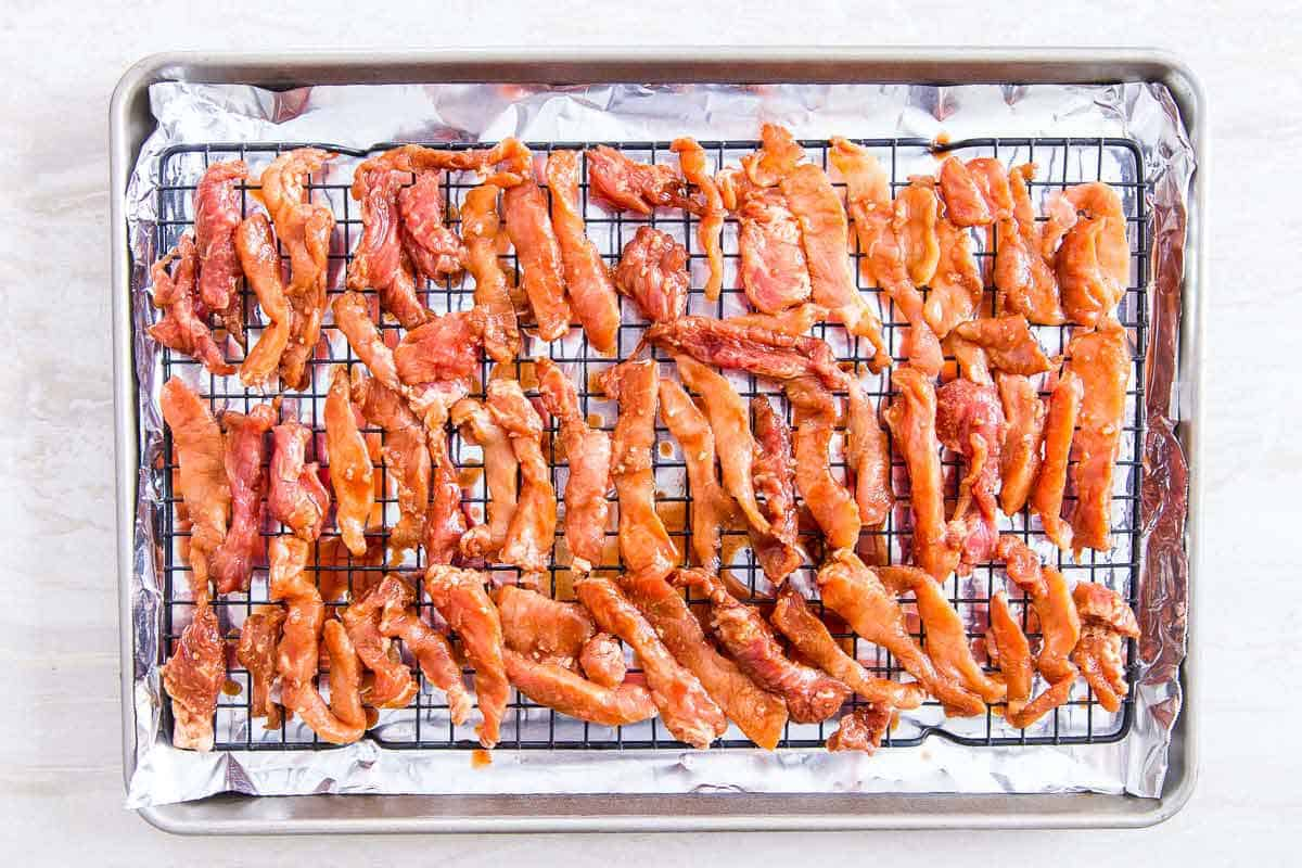 Chinese boneless spare ribs are baked on a rack in the oven for extra crispy edges.