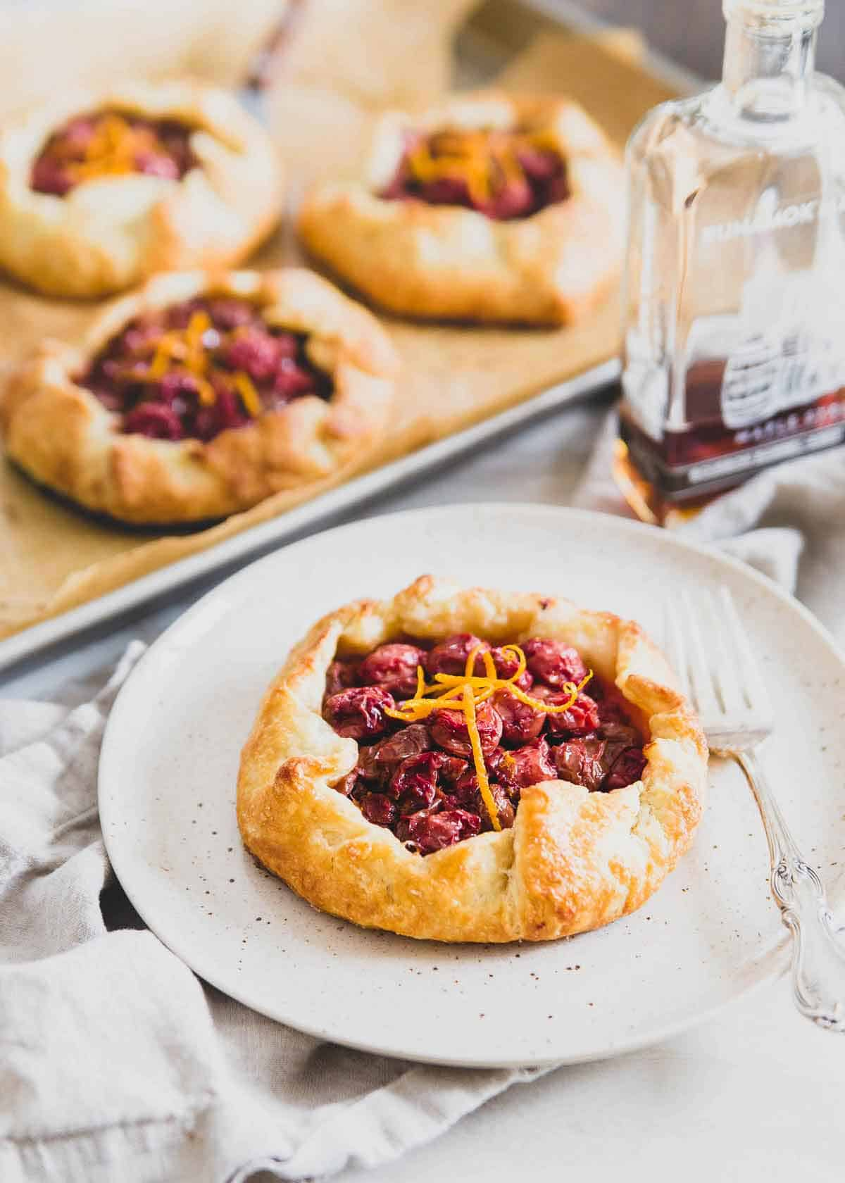 These cherry hand pies are filled with tart cherries, orange zest and sweetened with just a touch of maple syrup for a twist on the classic cherry pie.