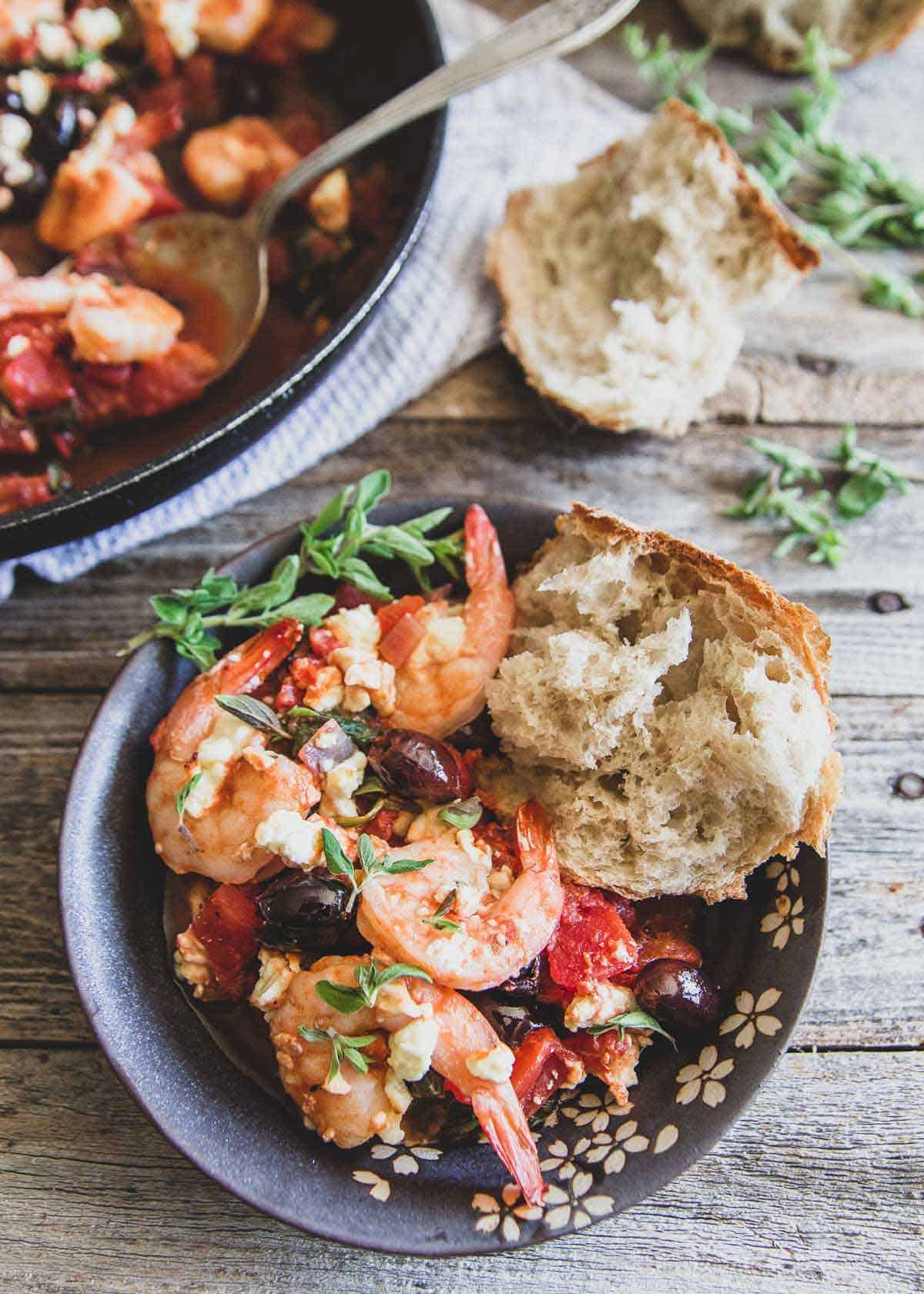 This Greek shrimp skillet is an easy 30 minute meal with tomatoes, spinach, Kalamata olives, feta and lots of fresh oregano and lemon flavor.