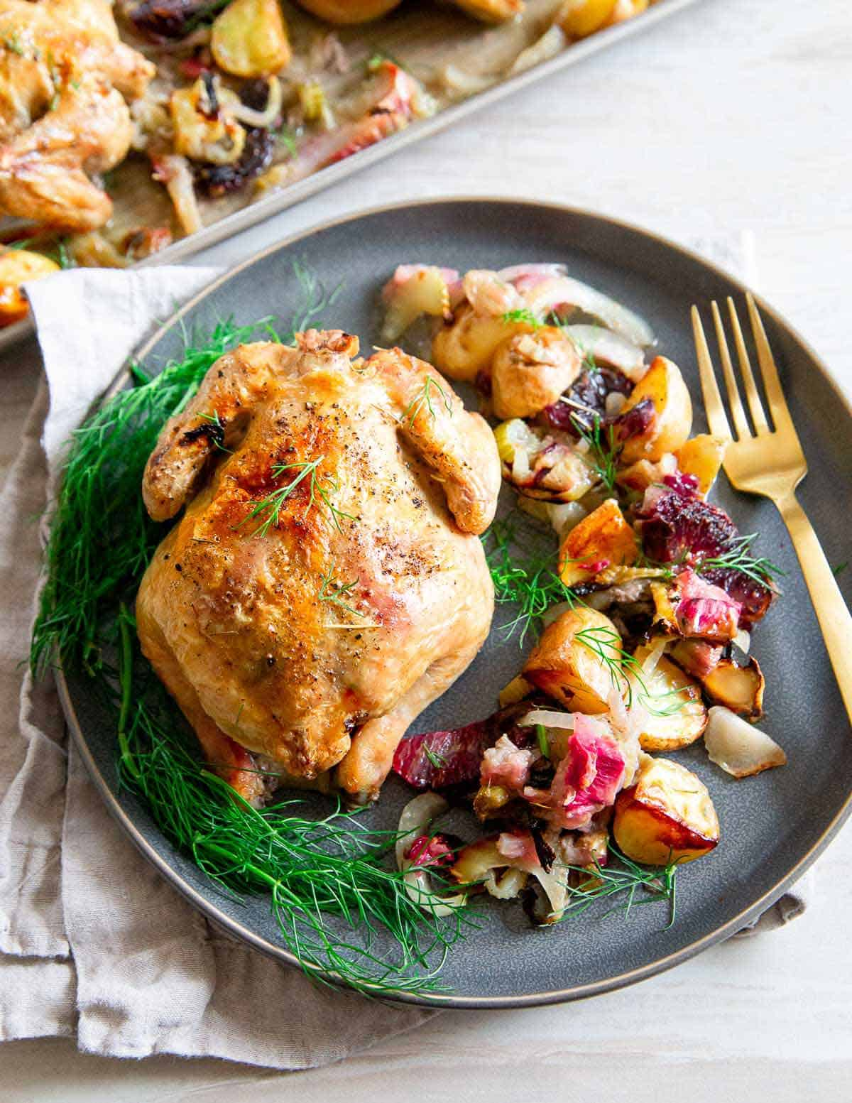 A stunning spring dinner, this easy sheet pan Cornish Game Hen recipe is packed with flavor.