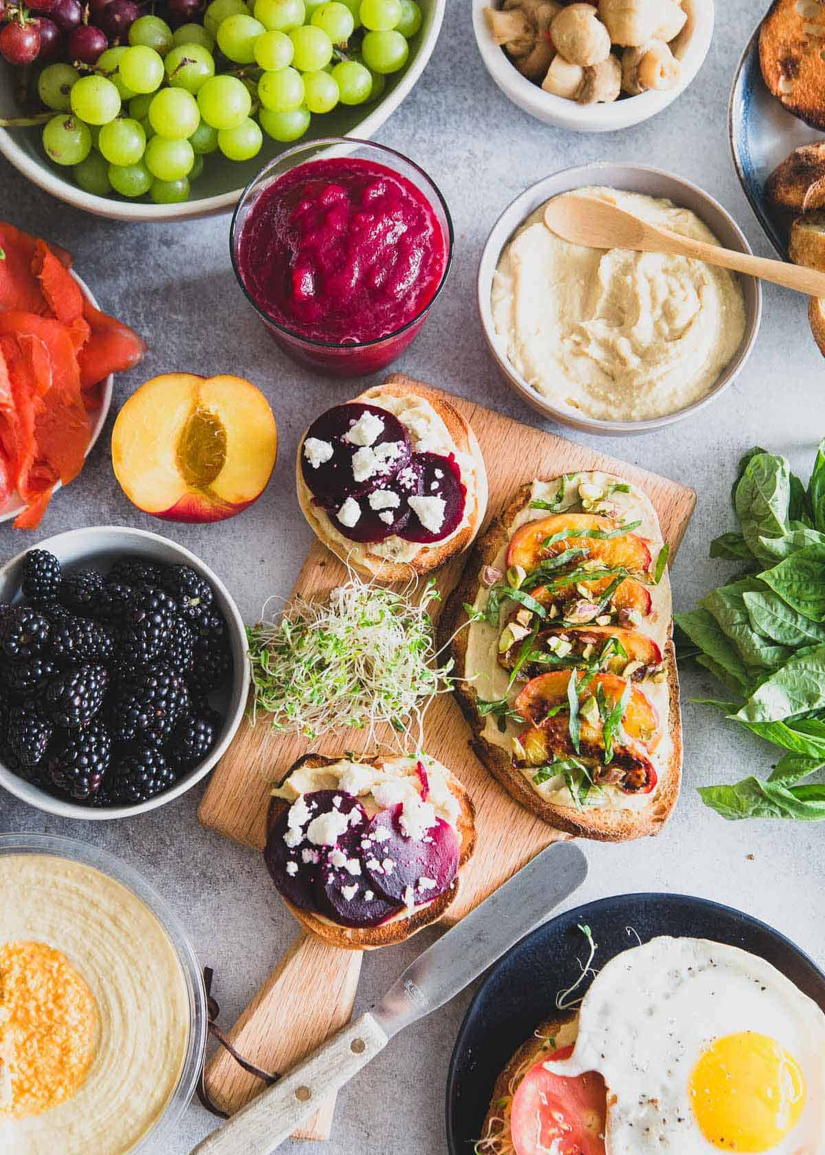 A healthy hummus toast brunch spread complete with a simple beet smoothie recipe to start the day.