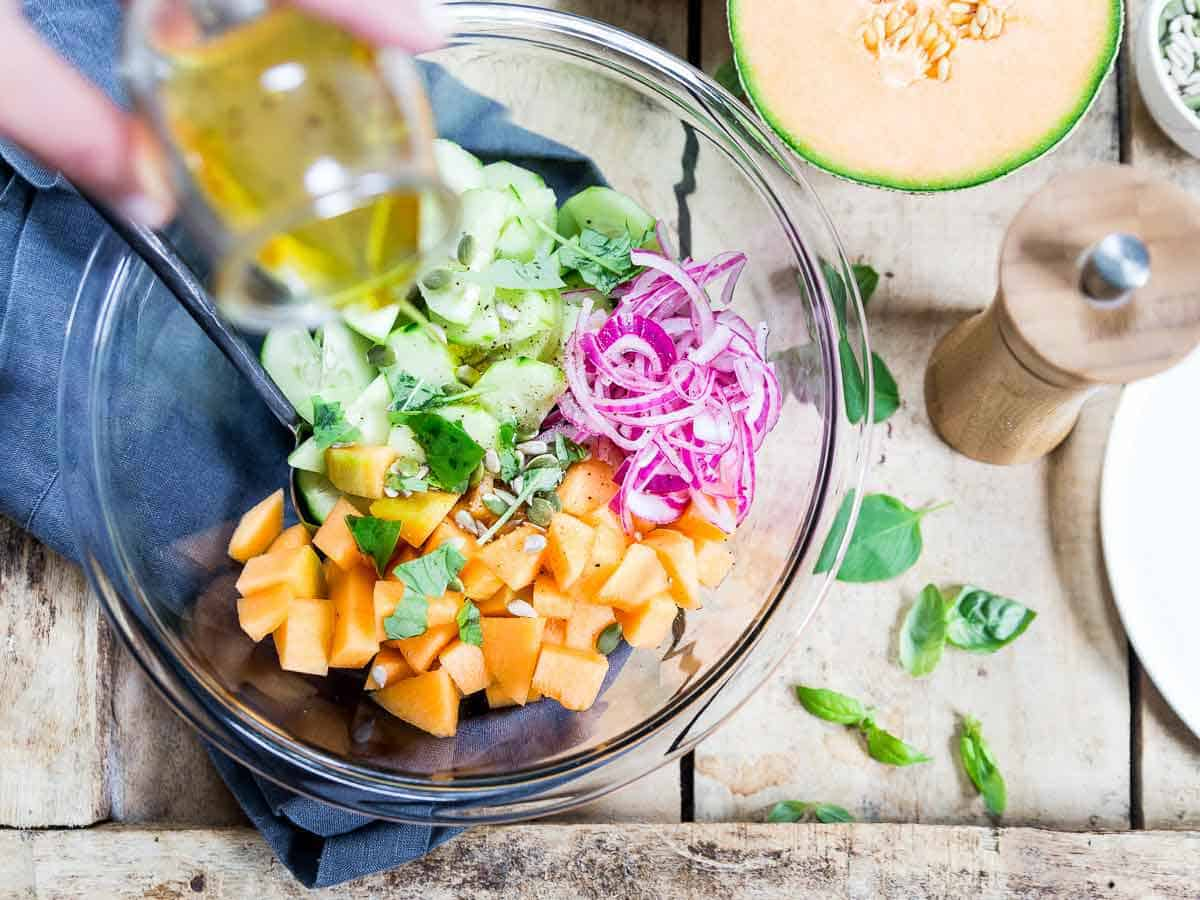 This summer cucumber salad uses sweet cantaloupe and pickled red onions, a refreshing addition to any grilled meal!