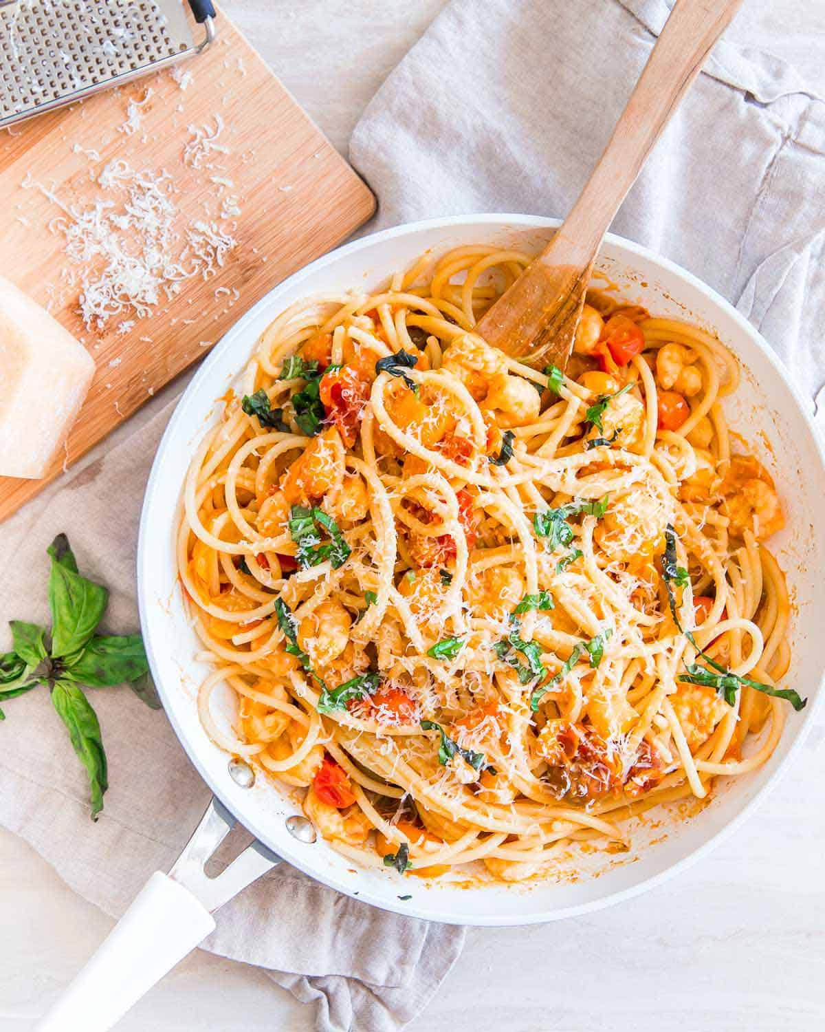 Easy, under 30 minute bucatini pasta recipe with garlic shrimp and cherry tomatoes.