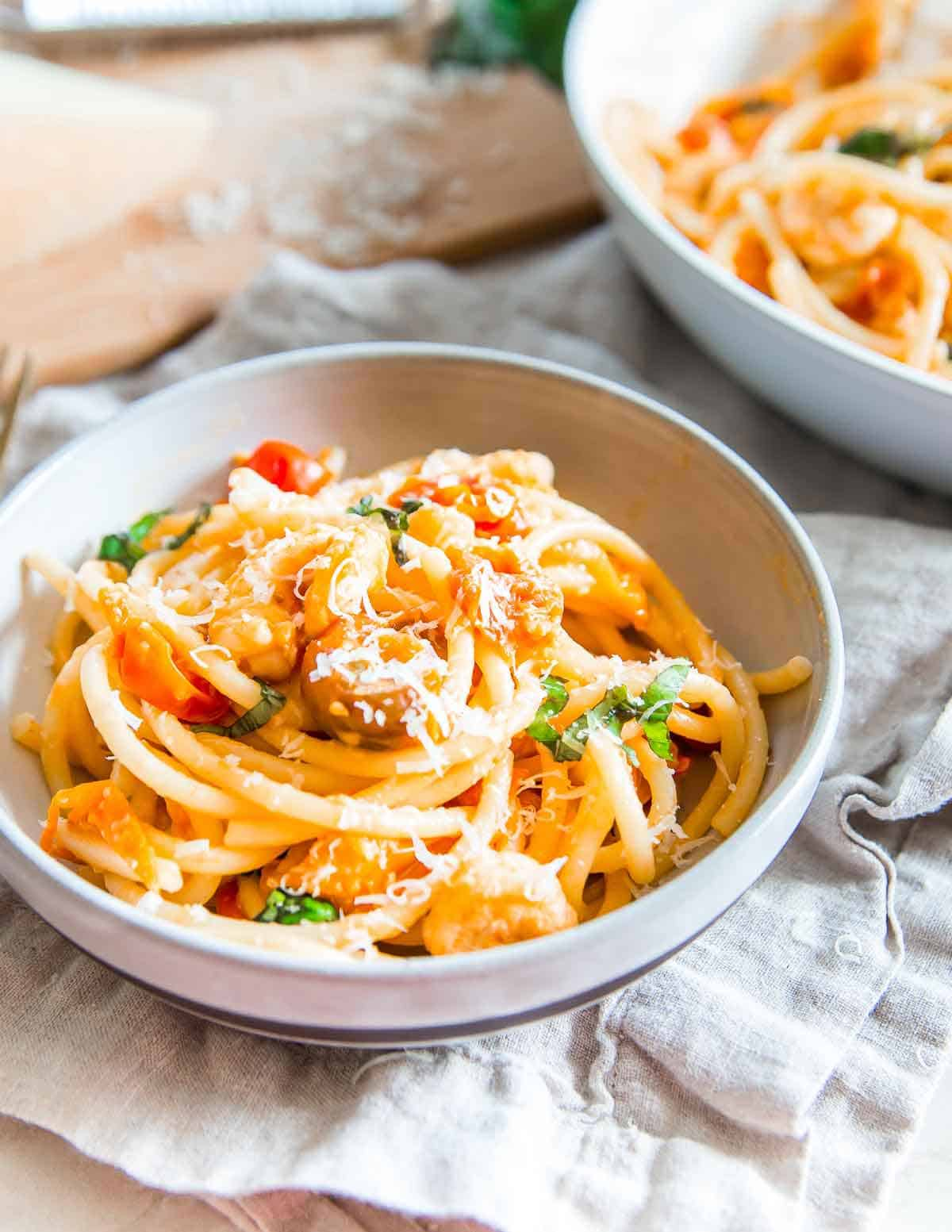 Looking for an easy weeknight meal? Grab some frozen shrimp, cherry tomatoes and a box of pasta from the pantry for this bucatini with garlic shrimp recipe.
