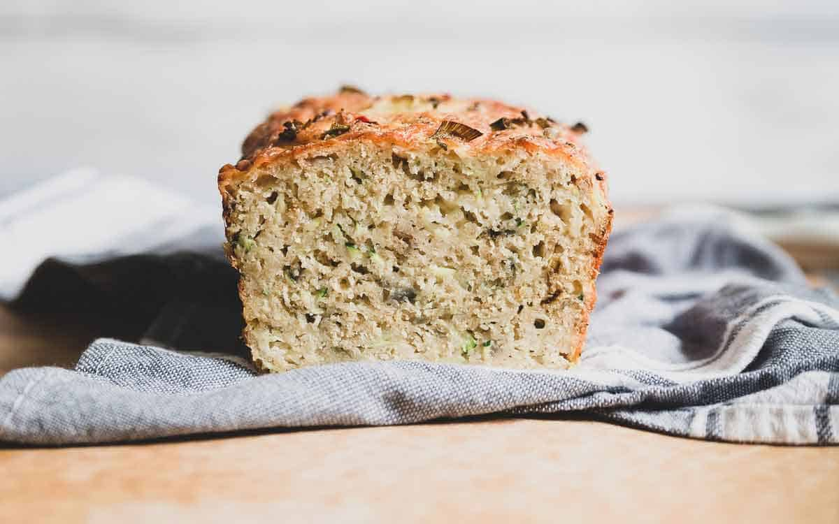 Hearty zucchini cheesy bread with savory red onions and spicy pepper jack cheese.