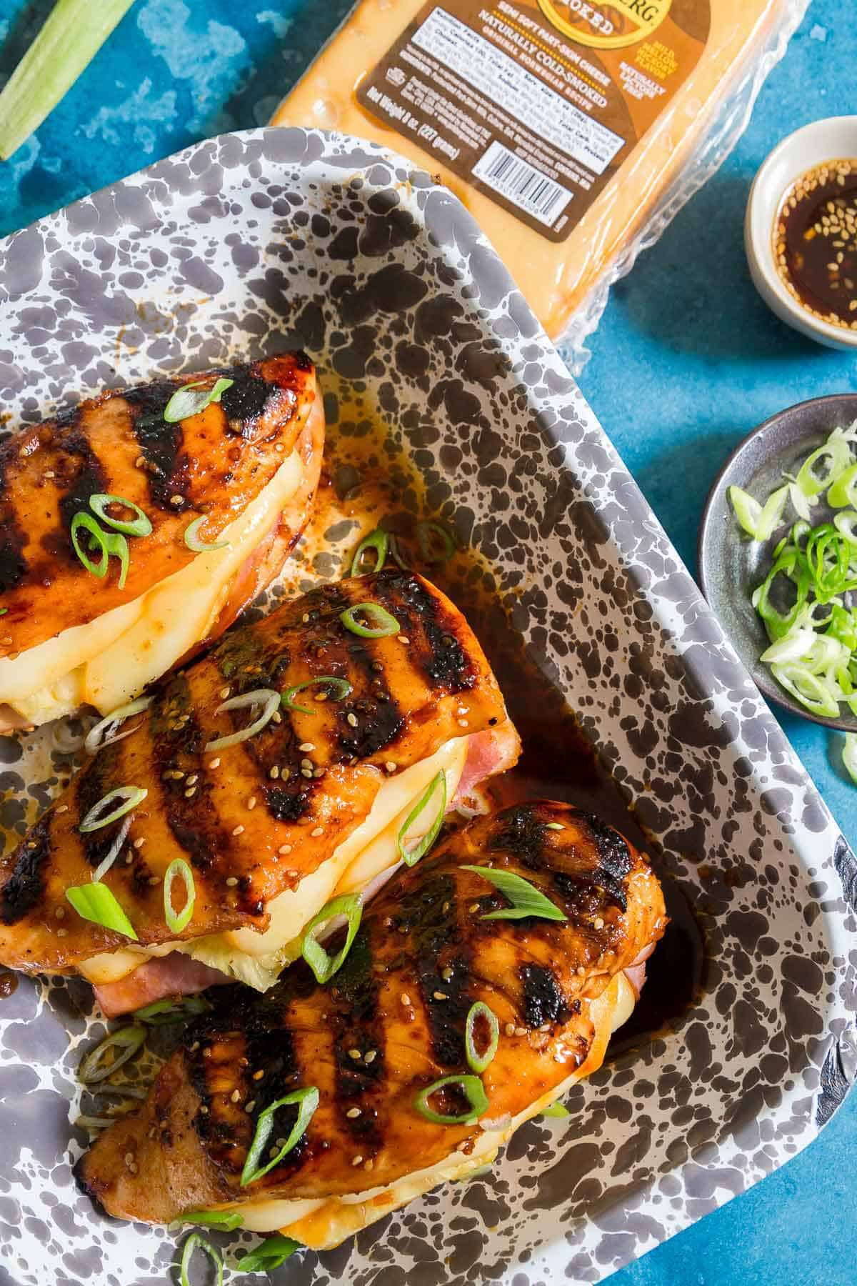 This grilled Hawaiian chicken is stuffed with ham, fresh pineapple and melted smoked Jarlsberg cheese with a sticky sweet teriyaki glaze.