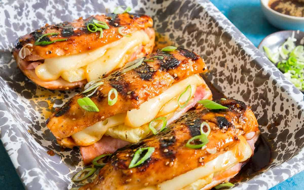 Hawaiian pineapple chicken with ham and melted cheese and a Teriyaki glaze.