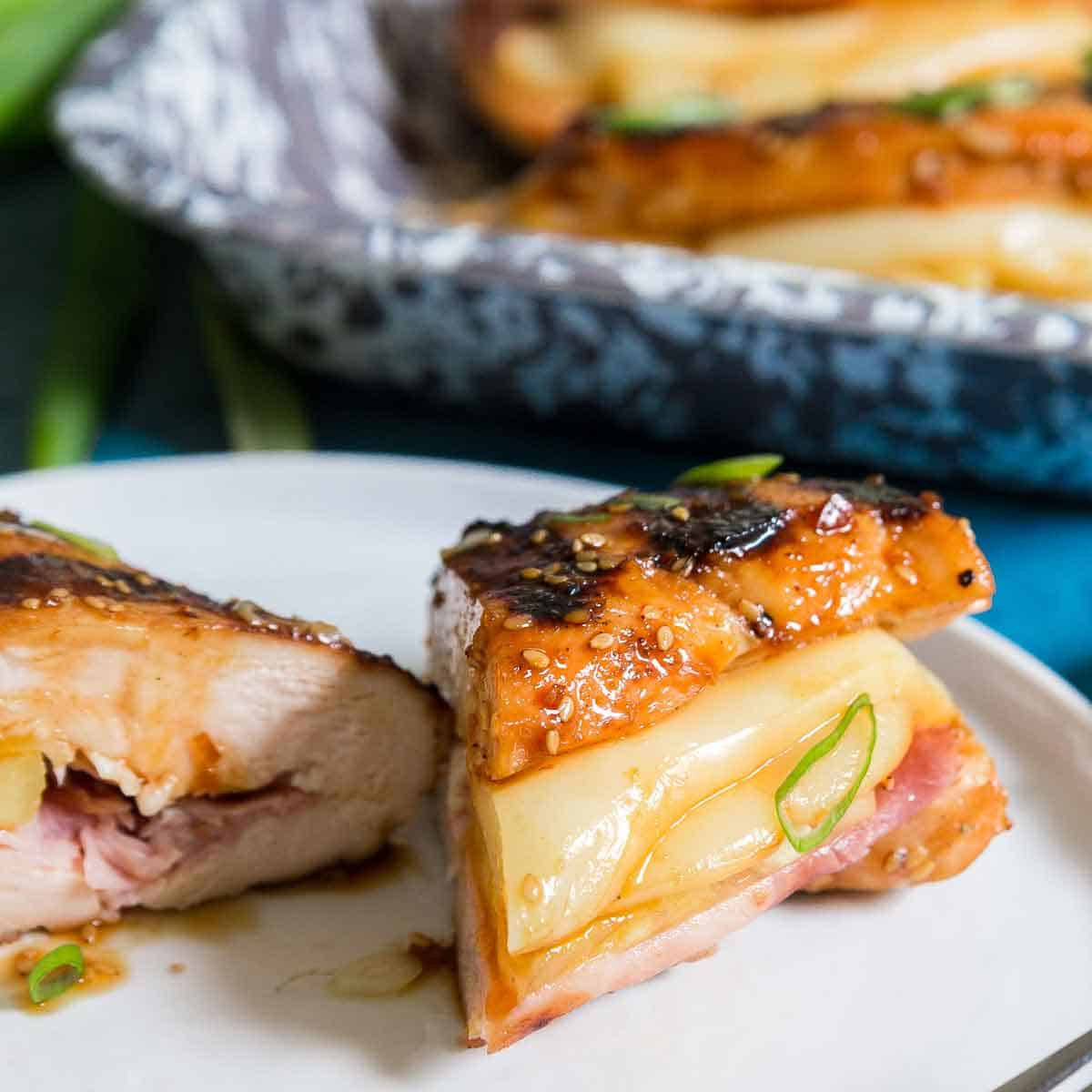 Hawaiian teriyaki chicken is stuffed with pineapple, ham and cheese and made on the grill.