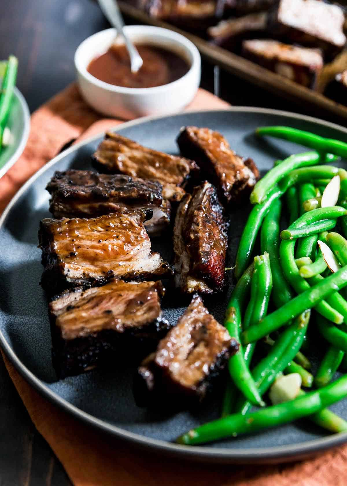 These lamb ribs are the easiest recipe to throw on the grill. Cooked low and slow over indirect heat then finished over a hot flame for crispiness they're packed with BBQ flavor!
