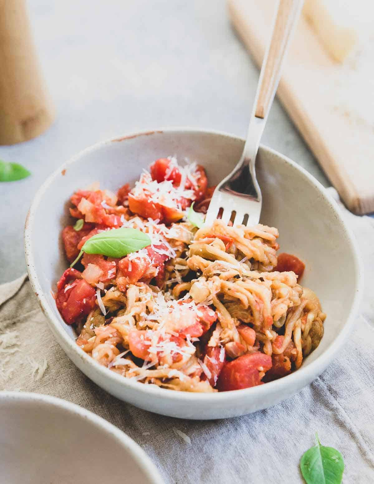 Spiralized eggplant is a lower carb alternative to pasta in this easy meatless meal.