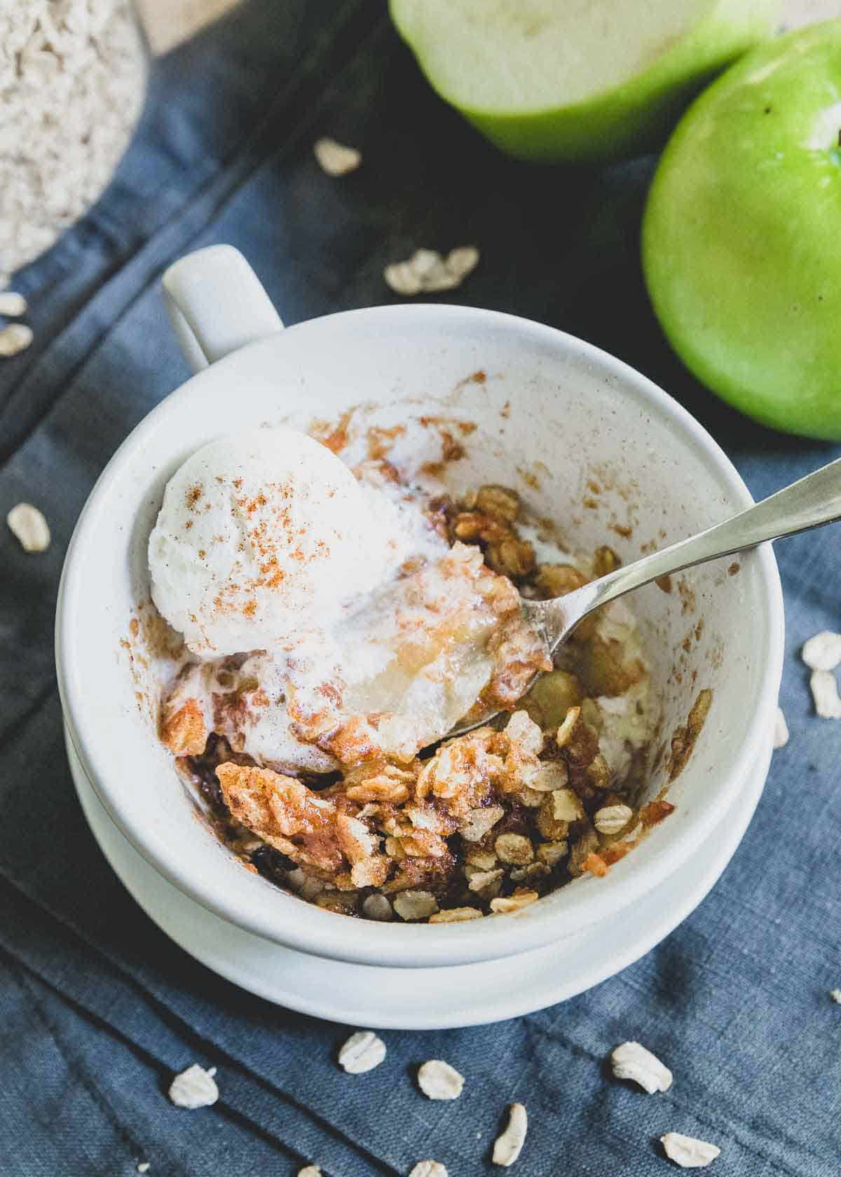 Quick and easy microwave apple crisp recipe that can be made in a mug or small ramekin to serve 1.